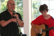 Father and son team up for an enchanting duet during the community BBQ. Photo Erin Perkins.
